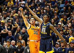 Feb 10, 2018; Morgantown, WV, USA; Oklahoma State Cowboys guard Jeffrey Carroll (30) shoots a three pointer during the first half against the West Virginia Mountaineers at WVU Coliseum. Mandatory Credit: Ben Queen-USA TODAY Sports
