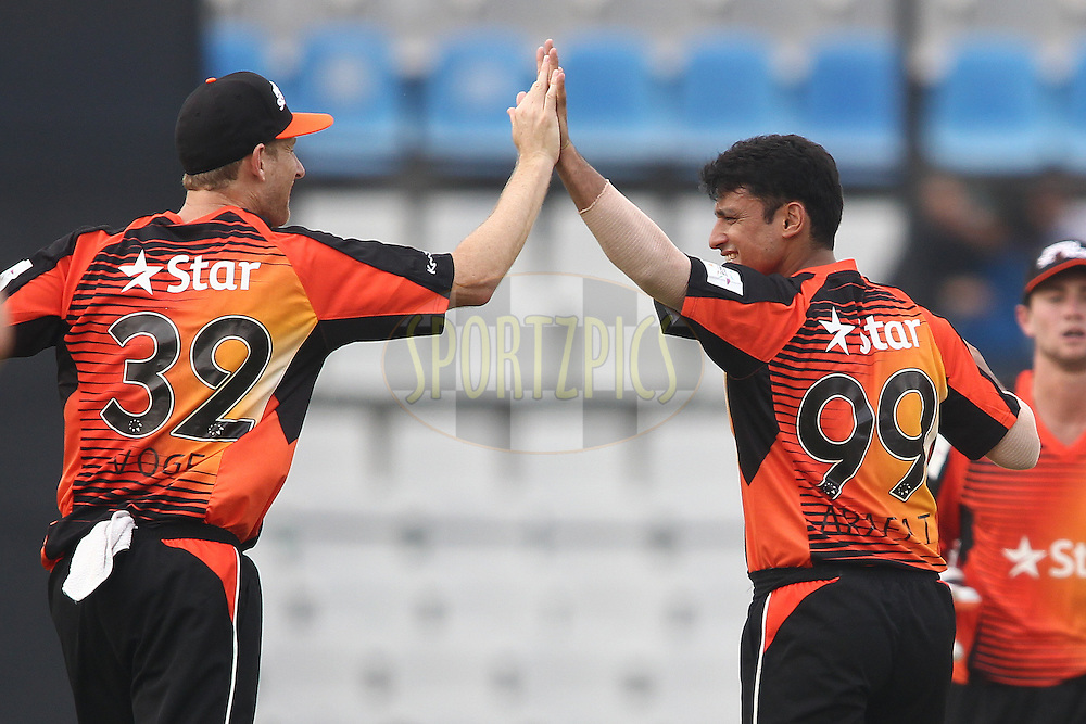 Perth Scorchers captain Adam Voges congratulates Yasir Arafat of the Perth Scorchers for getting Daryn Smit of the Dolphins wicket during match 4 of the Oppo Champions League Twenty20 between the Dolphins and the Perth Scorchers held at the Punjab Cricket Association Stadium, Mohali, India on the 20th September 2014<br /> <br /> Photo by:  Shaun Roy / Sportzpics/ CLT20<br /> <br /> <br /> Image use is subject to the terms and conditions as laid out by the BCCI/ CLT20.  The terms and conditions can be downloaded here:<br /> <br /> http://sportzpics.photoshelter.com/gallery/CLT20-Image-Terms-and-Conditions-2014/G0000IfNJn535VPU/C0000QhhKadWcjYs