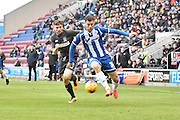 Wigan Athletic Forward, Yanic Wildschut looks to break away from the Bury defence during the Sky Bet League 1 match between Wigan Athletic and Bury at the DW Stadium, Wigan, England on 27 February 2016. Photo by Mark Pollitt.