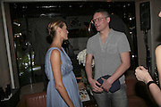 Yasmin le Bon and Giles Deacon, THE CHRISTMAS PARTY CELEBRATING THE 225TH ANNIVERSARY OF ASPREY. 167 NEW BOND ST. LONDON W1. 7 DECEMBER 2006. ONE TIME USE ONLY - DO NOT ARCHIVE  © Copyright Photograph by Dafydd Jones 248 CLAPHAM PARK RD. LONDON SW90PZ.  Tel 020 7733 0108 www.dafjones.com