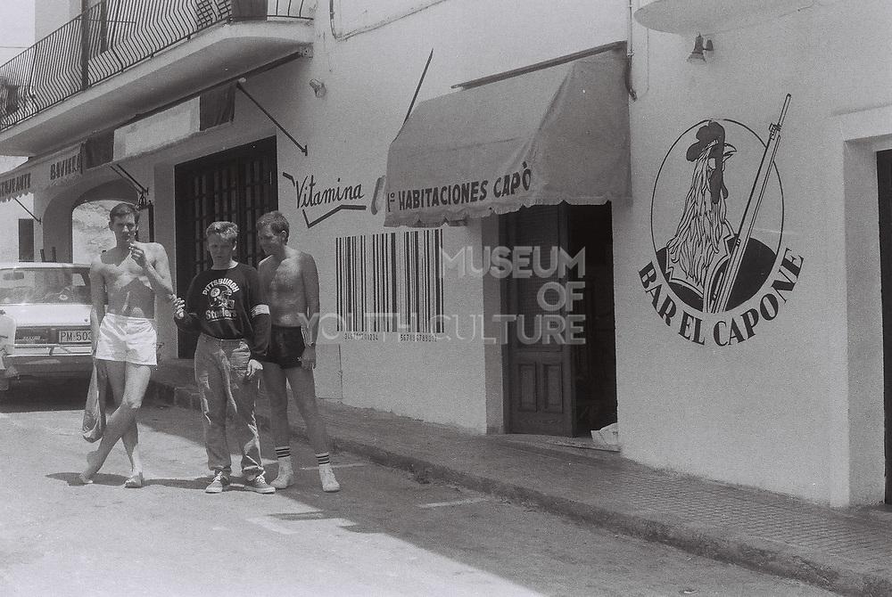 Teenage boys outside Bar El Capone, Ibiza, Spain, 1984