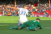 man of the moment Lyle Taylor of AFC Wimbledon slides in and puts AFC Wimbledon back in front during the Sky Bet League 2 match between York City and AFC Wimbledon at Bootham Crescent, York, England on 24 October 2015. Photo by Stuart Butcher.