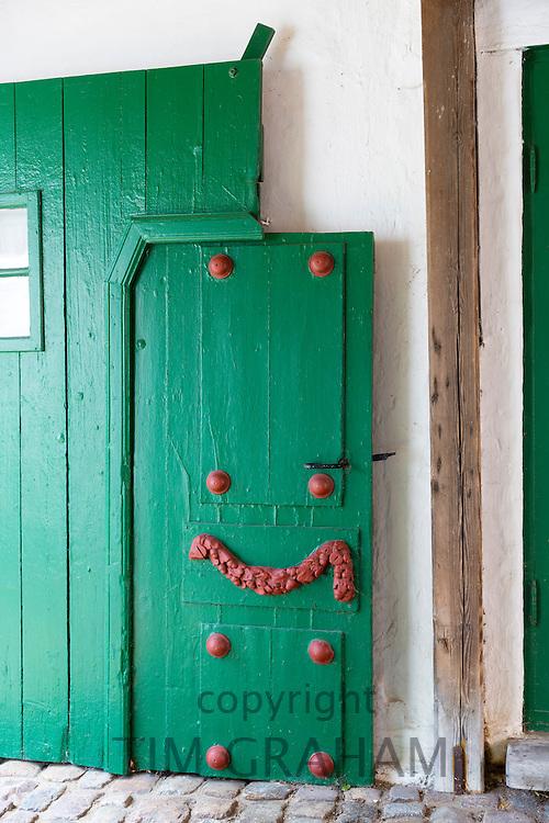 Painted green door in medieval Ribe centre, South Jutland, Denmark