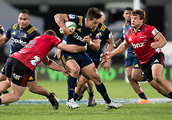 Highlanders' Rob Thompson, centre, makes a run against the Crusaders in the Super Rugby match, Forsyth Barr Stadium, Dunedin, New Zealand, Saturday, March 17, 2018. Credit:SNPA / Adam Binns ** NO ARCHIVING**
