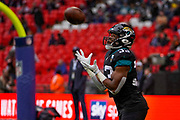 Jacksonville Jaguars Running Back Devine Ozigbo (33) warms up during the International Series match between Jacksonville Jaguars and Houston Texans at Wembley Stadium, London, England on 3 November 2019.