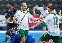 LONDON -  Unibet Eurohockey Championships 2015 in  London. Belgium v Ireland  . Peter Caruth (m) scored for Ireland 0-1 and celebrates with Alan Sothern. left Belgium goalie Vincent Vanasch (Gk) . WSP Copyright  KOEN SUYK