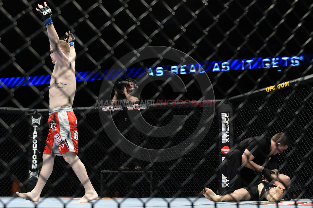 """LONDON, ENGLAND, FEBRUARY 21, 2009: Evan Dunham (left) celebrates after knocking out Per Eklund during """"UFC 95: Sanchez vs. Stevenson"""" inside the O2 Arena in Greenwich, London."""
