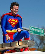 Superman rids atop a firetruck during the Dallas St. Patrick's Parade on Greenville Avenue, Saturday, March 16, 2013. (Cooper Neill/The Dallas Morning News)