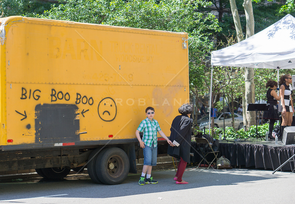 bot and his mother at a street fair in New York City