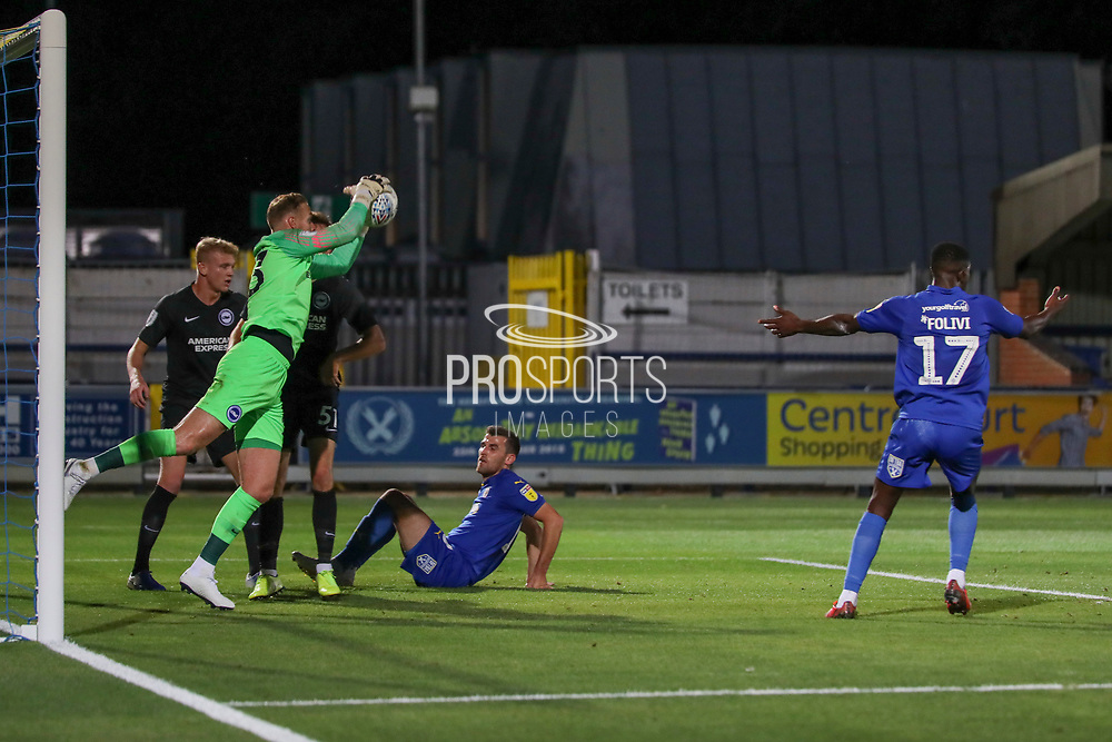 Brighton and Hove Albion goalkeeper Jason Steele (23) saves shot from AFC Wimbledon attacker Adam Roscrow (10) during the EFL Trophy (Leasing.com) match between AFC Wimbledon and U23 Brighton and Hove Albion at the Cherry Red Records Stadium, Kingston, England on 3 September 2019.