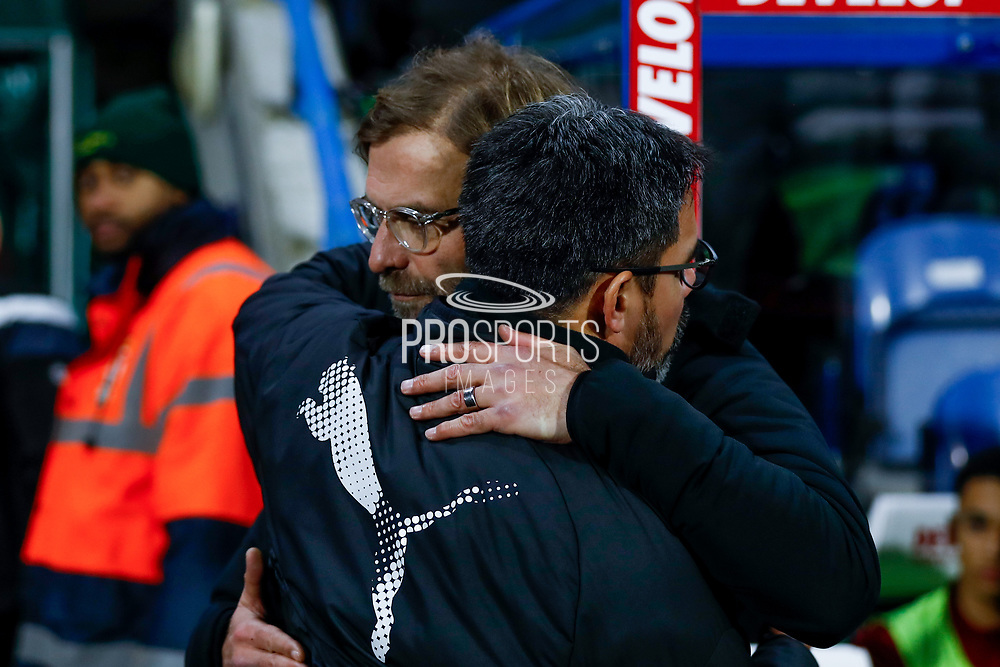 Liverpool manager Jurgen Klopp  and Huddersfield Town Manager David Wagner embrace before  the Premier League match between Huddersfield Town and Liverpool at the John Smiths Stadium, Huddersfield, England on 30 January 2018. Photo by Simon Davies.