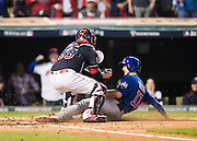 CLEVELAND, OH - NOVEMBER 2, 2016: Kris Bryant #17 of the Chicago Cubs slides safely home and scores on a sacrifice fly hit in the fourth inning by teammate Addison Russell #27 during Game 7 of the 2016 World Series against the Cleveland Indians at Progressive Field on November 2, 2016 in Cleveland, Ohio. (Photo by Jean Fruth)