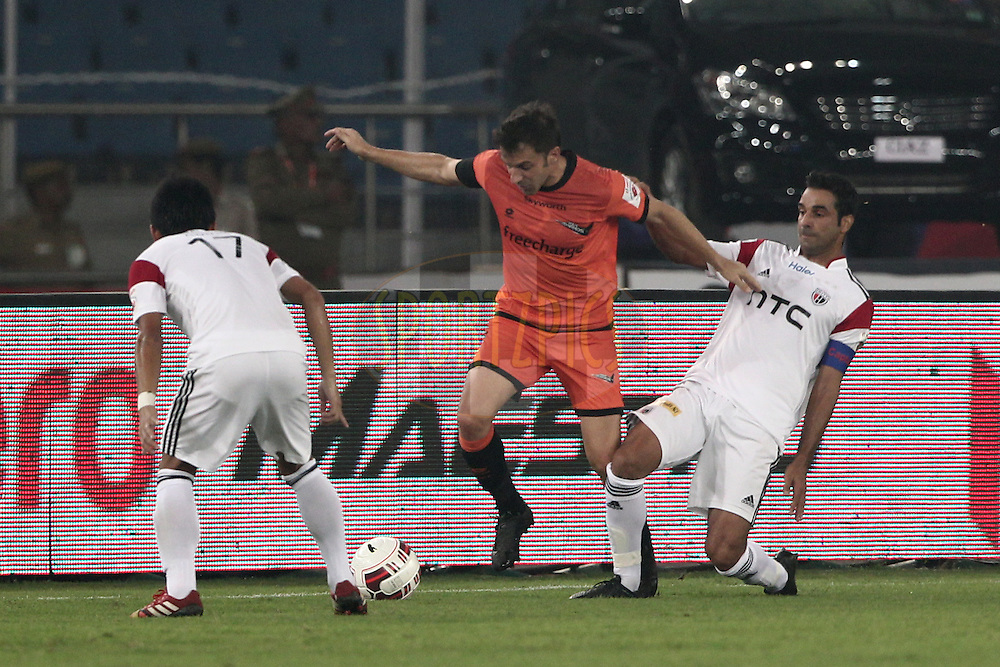 Alessandro Del Piero of Delhi Dynamos FC and Miguel Garcia of NorthEast United FC in action during match 16 of the Hero Indian Super League between The Delhi Dynamos FC and NorthEast United FC held at the Jawaharlal Nehru Stadium, Delhi, India on the 29th October 2014.<br /> <br /> Photo by:  Deepak Malik/ ISL/ SPORTZPICS