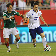 Hélder Postiga, (right), Portugal, challenged by Héctor Moreno, Mexico, during the Portugal V Mexico International Friendly match in preparation for the 2014 FIFA World Cup in Brazil. Gillette Stadium, Boston (Foxborough), Massachusetts, USA. 6th June 2014. Photo Tim Clayton