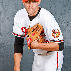 February 26, 2011; Sarasota, FL, USA; Baltimore Orioles relief pitcher Jim Johnson (43) poses during photo day at Ed Smith Stadium.  Mandatory Credit: Derick E. Hingle