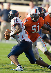 Virginia linebacker Clint Sintim (51) sacks Richmond quarterback Eric Ward (11).  The Virginia Cavaliers defeated the #3 ranked (NCAA Division 1 Football Championship Subdivision) Richmond Spiders 16-0 in a NCAA football game held at Scott Stadium on the Grounds of the University of Virginia in Charlottesville, VA on September 6, 2008.