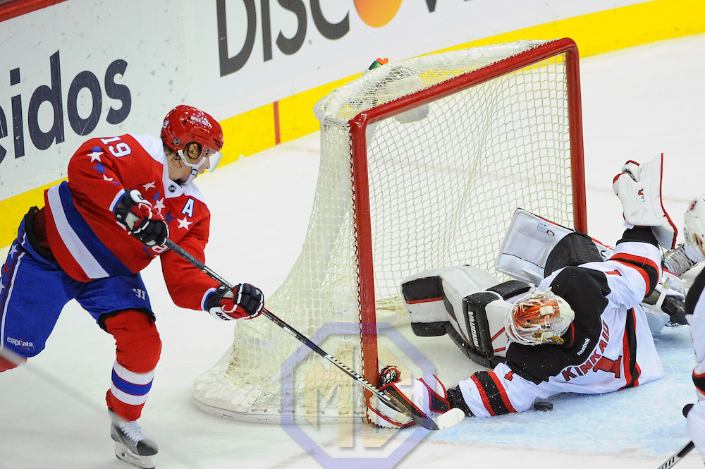 WASHINGTON, DC - DECEMBER 29: New Jersey Devils goalie Keith Kinkaid (1) makes a save on shot by Washington Capitals center Nicklas Backstrom (19) in the third period on December 29, 2016, at the Verizon Center in Washington, D.C. The New Jersey Devils defeated the Washington Capitals, 2-1 in a shootout. (Photo by Mark Goldman/Icon Sportswire)