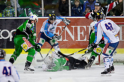 Jean-Philippe Lamoureux (HDD Tilia Olimpija, #1) covers a puck during ice-hockey match between HDD Tilia Olimpija and SAPA Fehervar AV19 at second match in Quarterfinal  of EBEL league, on Februar 21, 2012 at Hala Tivoli, Ljubljana, Slovenia. (Photo By Matic Klansek Velej / Sportida)