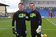 Kick it Out, no to racism AFC Wimbledon goalkeeper James Shea (1) and AFC Wimbledon goalkeeper Joe McDonnell (24) prior the EFL Sky Bet League 1 match between Oldham Athletic and AFC Wimbledon at Boundary Park, Oldham, England on 12 November 2016. Photo by Stuart Butcher.