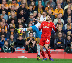 25.10.2014, Anfield, Liverpool, ENG, Premier League, FC Liverpool vs Hull City, 9. Runde, im Bild Liverpool's Adam Lallana in action against Hull City's James Chester // during the English Premier League 9th round match between Liverpool FC and Hull City at the Anfield in Liverpool, Great Britain on 2014/10/25. EXPA Pictures © 2014, PhotoCredit: EXPA/ Propagandaphoto/ David Rawcliffe<br /> <br /> *****ATTENTION - OUT of ENG, GBR*****