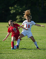 Berlin's Trinity Genderon and Laconia's Skyler Tautkus go after possession of the ball during Tuesday afternoons NHIAA Division III soccer at Robbie Mills Field.  (Karen Bobotas/for the Laconia Daily Sun)