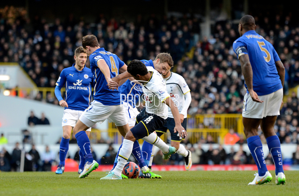 Paulinho tackles Danny Drinkwater during the The FA Cup match between Tottenham Hotspur and Leicester City at White Hart Lane, London, England on 24 January 2015. Photo by Alan Franklin.