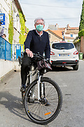 cyclist with mask during the Covid 19 crisis and lockdown France Limoux April 2020