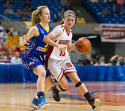 Sissonville guard Karli Pinkerton (10) tries to get around Clay County guard Payton Lucas (3) during a first round game at the Charleston Civic Center.