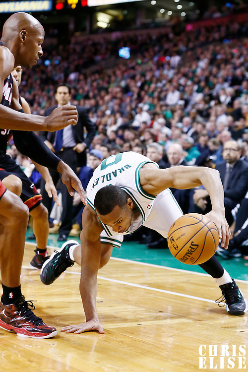 27 January 2013: Boston Celtics point guard Avery Bradley (0) almost fells while dribbling as Miami Heat shooting guard Ray Allen (34) defends on him during the Boston Celtics 100-98  2OT victory over the Miami Heat at the TD Garden, Boston, Massachusetts, USA.