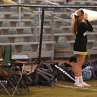 Adam Robison | BUY AT PHOTOS.DJOURNAL.COM<br /> A Ripley cheerleader sticks her head inside a megaphone as she watches members of her squad walk towards her before kickoff against Pontotoc Friday night.