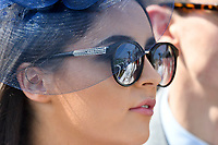 National Hunt Horse Racing - 2019 Randox Health Grand National Festival - Saturday, Day Three (Grand National Day)<br /> <br /> female racegoers in sunglasses watches  the 1.45 Gaskells Handicap Hurdle (Grade 3) (Class 1)<br /> at Aintree Racecourse.<br /> <br /> COLORSPORT/WINSTON BYNORTH