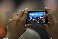 A member of the audience records a video of Vice President Joe Biden as he speaks at Iowa State University in Ames, Iowa on Thursday, March 1, 2012.