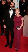 Feb 8, 2015 - EE British Academy Film Awards 2015 - Red Carpet Arrivals at Royal Opera House<br /> <br /> Pictured: Eric White and Patricia Arquette<br /> ©Exclusivepix Media