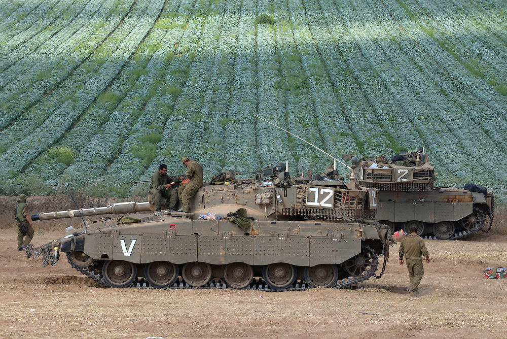 UNSPECIFIED, ISRAEL - JULY 19, 2014: IDF tanks in an army deployment area near Israel's border with the Gaza Strip, on July 19, 2014,  on the second day of Israeli ground invasion into Gaza Strip in order to destroy terror tunnels infrastructure. Photo by Gili Yaari