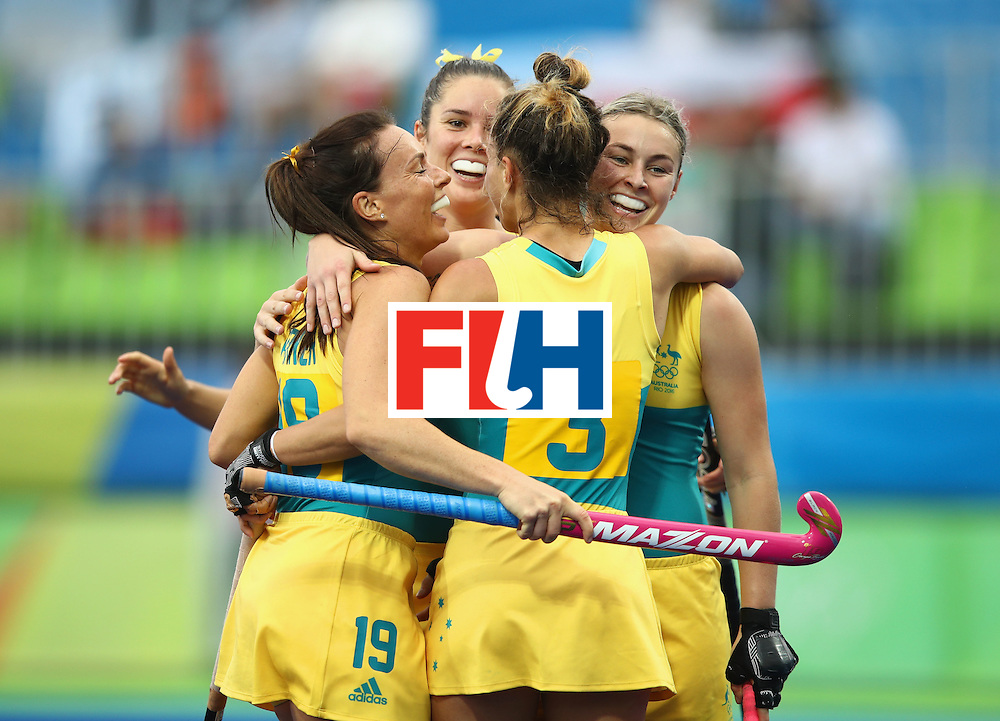 RIO DE JANEIRO, BRAZIL - AUGUST 10:  Georgie Parker, Brooke Peris and Mariah Williams of Australia celebrate a goal during the Women's Pool B Match between India and Australia on Day 5 of the Rio 2016 Olympic Games at the Olympic Hockey Centre on August 10, 2016 in Rio de Janeiro, Brazil.  (Photo by Mark Kolbe/Getty Images)