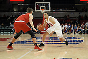 SMU Mustangs forward Ethan Chargois (25) penetrates the top of the key against Hartford Hawks forward Miroslav Stafl (12) during an NCAA college basketball game, Wednesday, Nov. 27, 2019, in Dallas.SMU defeated Hartford 90-58. (Wayne Gooden/Image of Sport)