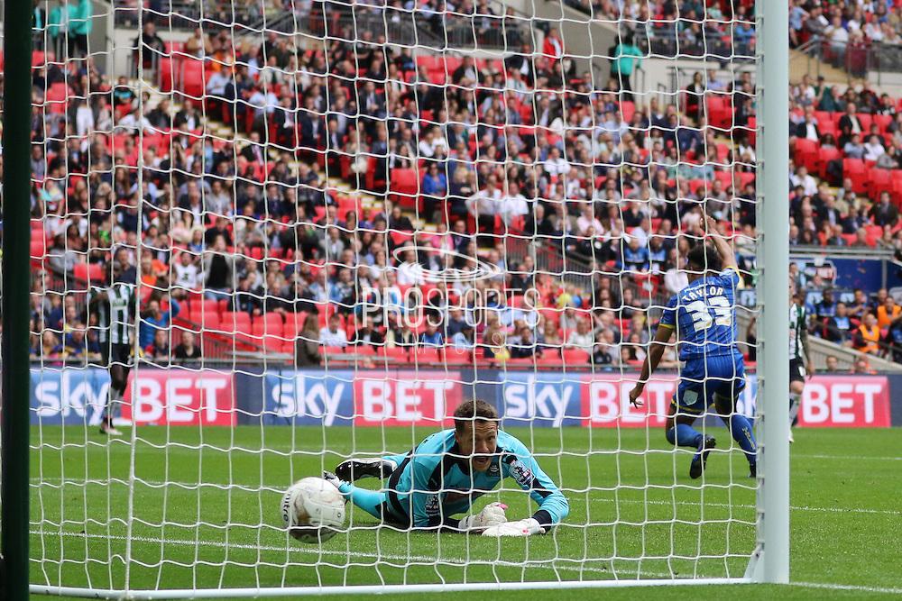 Lyle Taylor forward for AFC Wimbledon (33) scores to put AFC Wimbledon 1-0 up during the Sky Bet League 2 play off final match between AFC Wimbledon and Plymouth Argyle at Wembley Stadium, London, England on 30 May 2016. Photo by Stuart Butcher.