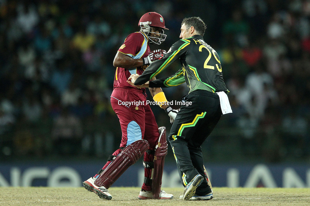 David Hussey stops the ball from hittinh Dwayne Bravo of The West Indies during the ICC World Twenty20 semi final match between Australia and The West Indies held at the Premadasa Stadium in Colombo, Sri Lanka on the 5th October 2012<br /> <br /> Photo by Ron Gaunt/SPORTZPICS