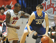 """Kentucky's Kyle Wiltjer (33) works against Mississippi's Murphy Holloway (31) at the C.M. """"Tad"""" Smith Coliseum on Tuesday, January 29, 2013. Kentucky won 87-74. (AP Photo/Oxford Eagle, Bruce Newman).."""