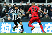Ayoze Perez (#17) of Newcastle United takes on Mathias Zanka Jorgensen (#25) of Huddersfield Town during the Premier League match between Newcastle United and Huddersfield Town at St. James's Park, Newcastle, England on 31 March 2018. Picture by Craig Doyle.