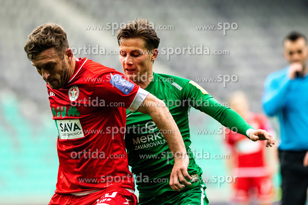Savic Stefan of NK Olimpija Ljubljana  vs Muminovic Sanin of NK Aluminij during football match between NK Olimpija Ljubljana and NK Aluminij in Round #27 of Prva liga Telekom Slovenije 2018/19, on April 14th, 2019 in Stadium Stozice, Slovenia Photo by Matic Ritonja / Sportida