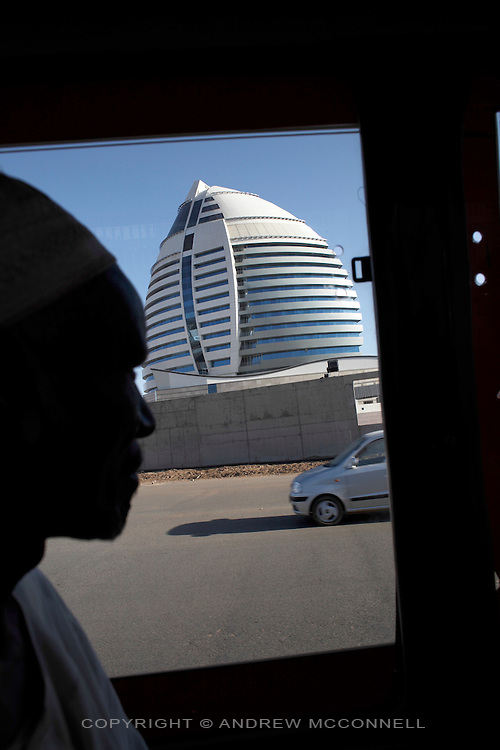 The Borj Al-Fateh Hotel in central Khartoum, Sudan, on Sunday, Apr. 15, 2007. The hotel, designed to represent a sail, opened in November 2007..Khartoum is modeling itself as the Dubai of Africa and despite Western sanctions the city is booming. Away from the troubles and poverty that plaque the rest of Sudan, development in Khartoum is moving at an astonishing rate. Investment from the East, and in particular China, allowed the Sudanese economy to grow by 11% in 2007. This growth is driven largely by oil, with production rising from 63,000 barrels per day in 1999 to over 500,000 barrels today.