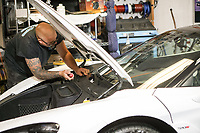 Gary Fantasia, owner of Ideal Glass replaces the windshield on a high end automobile 09-18-18
