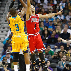 February 12, 2011; New Orleans, LA, USA; New Orleans Hornets point guard Chris Paul (3) shoots over Chicago Bulls point guard Derrick Rose (1) during the third quarter at the New Orleans Arena.  The Bulls defeated the Hornets 97-88. Mandatory Credit: Derick E. Hingle
