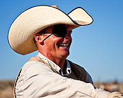 """Cowboy hats show a great deal of personal individuality. Scotty Hall, manager of the North Pueblo Ranch in Colorado, wears a style called the """"taco hat""""."""