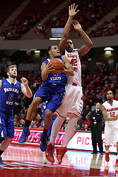 31 December 2014:  Brenton Scott body bumps Will Ransom on his way to the basket during an NCAA Division 1 Missouri Valley Conference (MVC) men's basketball game between the Indiana State Sycamores beat the Illinois State Redbirds 63-61 at Redbird Arena in Normal Illinois