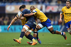 Aled Brew of Bath Rugby tackles Fritz Lee of Clermont Auvergne - Mandatory byline: Patrick Khachfe/JMP - 07966 386802 - 15/12/2019 - RUGBY UNION - Stade Marcel-Michelin - Clermont-Ferrand, France - Clermont Auvergne v Bath Rugby - Heineken Champions Cup