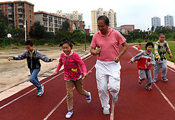 KUNMING, Sept. 7, 2016 (Xinhua) -- Dai Jianrong (C) runs with students at Xinmeng School in Wuhua District of Kunming, capital of southwest China's Yunnan Province, Sept. 6, 2016. 42-year-old Dai Jianrong devoted himself to conducting sports training for students with psychological problems or physical disabilities to help them gain pleasures and senses of achievements. (Xinhua/Lin Yiguang)(wsw) (Credit Image: © Lin Yiguang/Xinhua via ZUMA Wire)