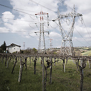 A house surrounded by high voltage pylons near th poerhouse of Villanova (PE). The powerhouse is currently being upgraded to cope with the influx of electricity coming from the Balkans and the energy demand of the new power line of 380Kv. Once upgraded, the skies in this area will literally be covered by a grid of cables.<br />