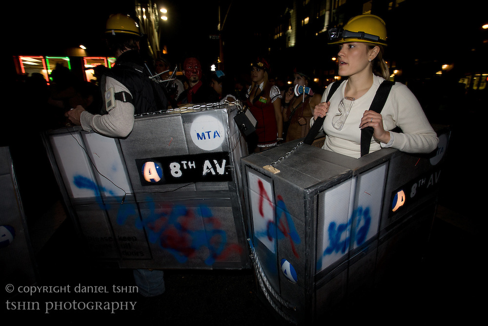 A couple dressed as 8th Ave A-train subway cars